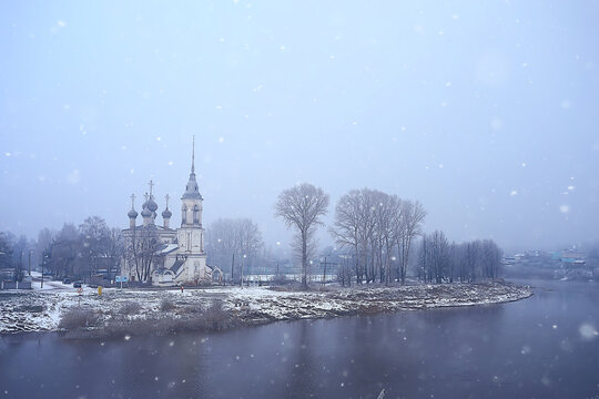 winter landscape church on the banks of the freezing river in vologda, christianity baptism russia christmas