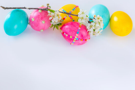 Easter eggs and flower branch on white background