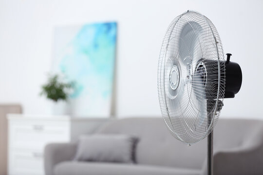 Modern electric fan in room. Space for text