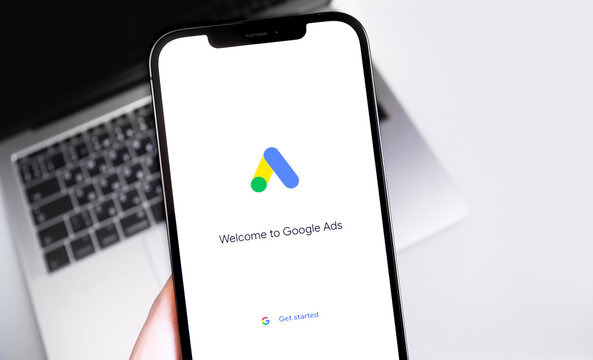 Google Ads (AdWords) logo on the screen iPhone, notebook background closeup. Google is the biggest Internet search engine in the world. Moscow, Russia - December 5, 2020