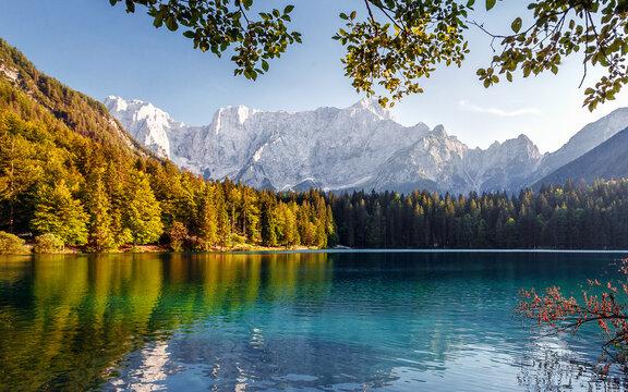 Impressively beautiful Fairy-tale mountain lake in Alps. Wonderful view of beautiful mountain landscape with calm lake Fusine.