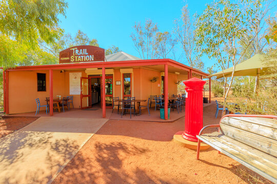Alice Springs, Northern Territory, Australia - Aug 14, 2019: Alice Springs telegraph station with red mailbox of post office. Historic landmark in Alice Springs, Northern Territory, Central Australia.
