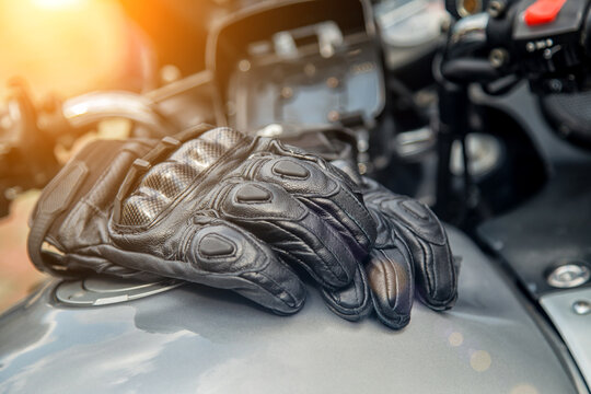 moto gloves. Motorcyclist arm protection.View of motorcycle accessories. Items included motorcycle helmet, keys and jacket. Motorcycle travel dream concept.