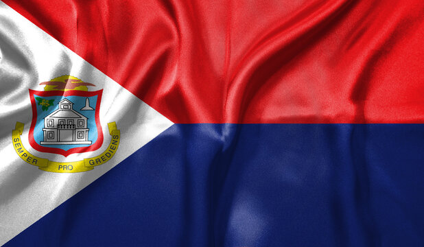 Sint Maarten flag wave close up. Full page Sint Maarten flying flag. Highly detailed realistic 3D rendering