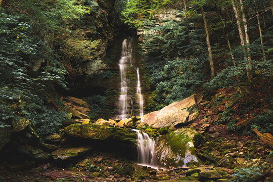 Small waterfall in summer woods