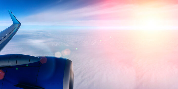 Airplane flight background. View from the airplane window to the sky and clouds.