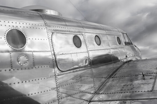 Shiny fuselage of an historic airplane in black and white