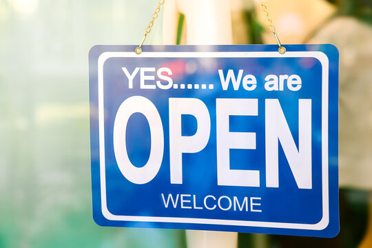 Yes We are Open sign hang on the glass of the doors in store.