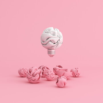 Floating crumpled paper light bulb on pink background, 3d rendering.