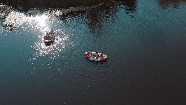 water rescue operation, a man overboard and a rescue service rescues him. The view from the helicopter