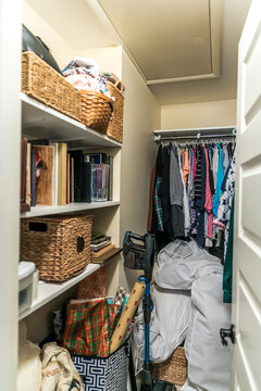 A messy and unorganized walk in closet