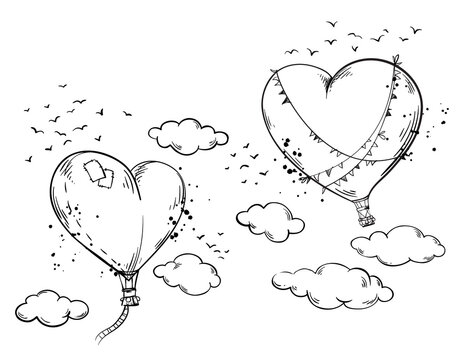 Heart shaped hot air baloons soaring in the air among clouds, romantic atmosphere