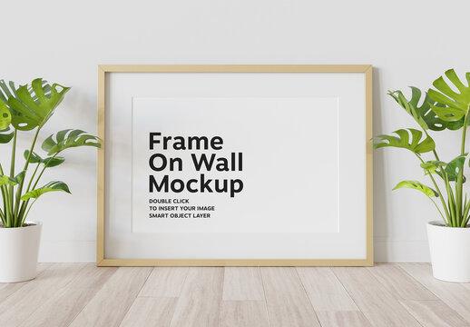 Black Frame Leaning on Wall Mockup