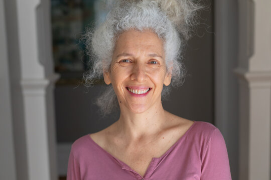 Portrait of senior caucasian woman looking at camera and smiling