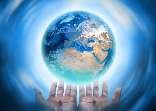 Hands of Christ saving the earth conceptual theme