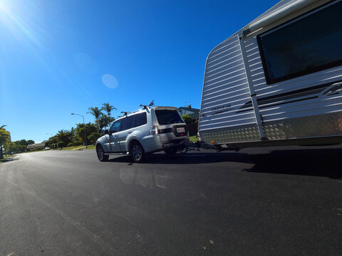 BRIBIE ISLAND, AUSTRALIA - Jan 14, 2021: 4wd towing a caravan on the road on a sunny day