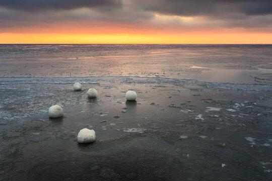 Frozen ice balls on the beach in Jastarnia during winter. Hel Peninsula, Poland