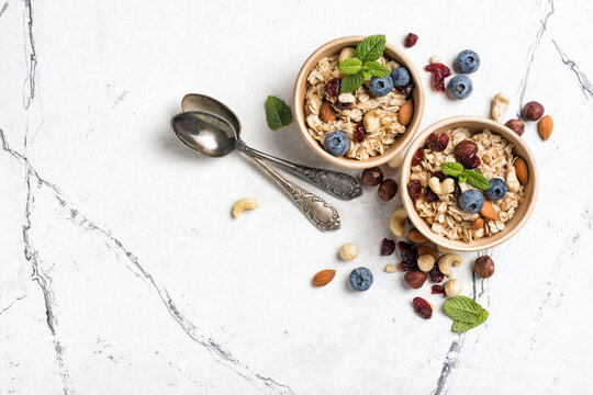 Healthy breakfast with oatmeal, berry, nuts and mint