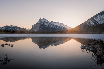 Mountains reflected in the Vermilion Lake in Banff National Park in winter