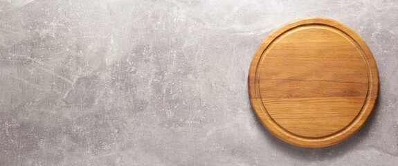 Pizza or bread cutting board for homemade baking on table. Food recipe concept at stone background texture