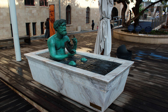 Haifa, Israel - December 5, 2013: Statue of Archimedes in a bathtub, demonstrating principle of buoyant force. Located at Madatech, Israel's National Museum of Science, Technology, and Space.