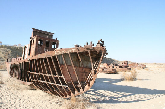 Moynaq (Mo'ynoq or Muynak), Uzbekistan - Desember 06 2019:  an abandoned rusty ship in the Aral sea. Ecological disaster. Dry bottom of the Aral Sea. World famous as the largest man made disaster.