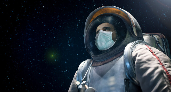 Astronaut looking at the infinite space while wearing a mask, covid coronavirus funny concept