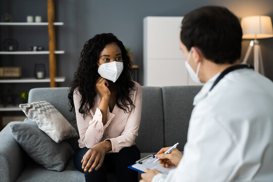 African Patient In Living Room At Home