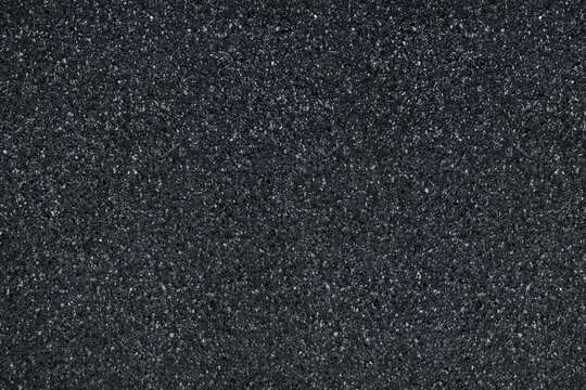 dark grey asphalt pavement texture with small rocks