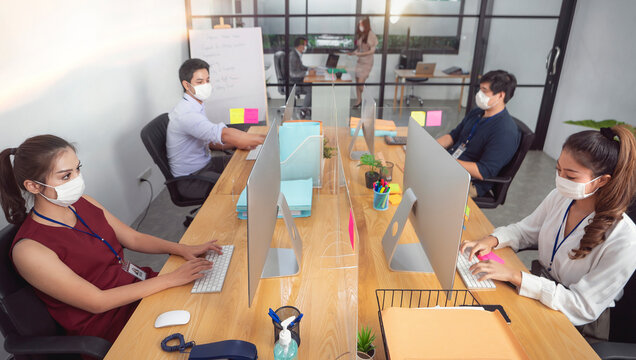 office worker are working and wear mask