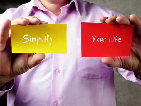 Business concept meaning Simplify Your Life with inscription on the piece of paper.