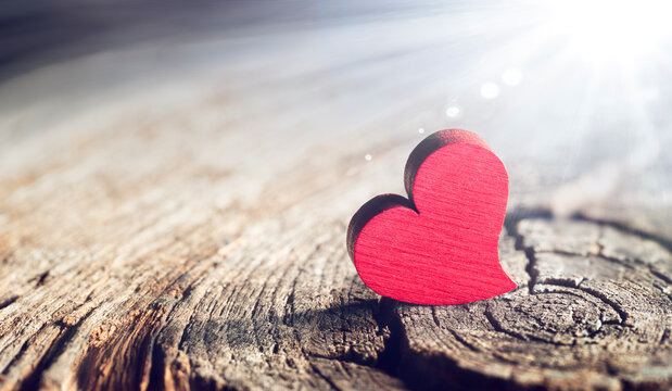 Wooden Heart With Sunlight And Flare Effect In Defocused Background - Valentines Day