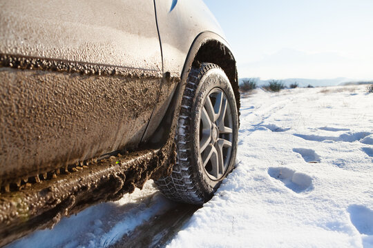 The four-wheel drive car of the modern SUV remains on the side of the winter road.