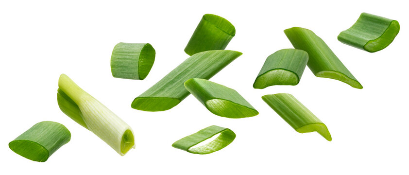 Falling green onion slices, cut chives isolated on white background