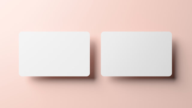 Blank credit card mockup front and back over a neutral background in realistic 3D rendering. Rounded corners business card mock up for design template