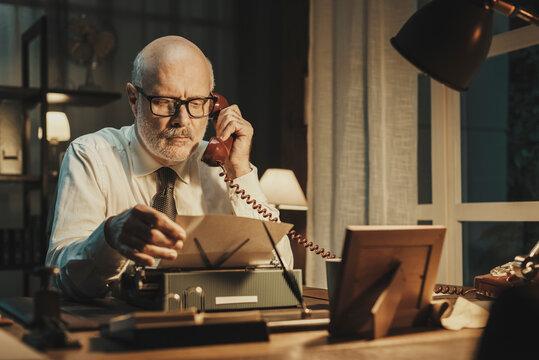 Vintage style businessman having a phone call