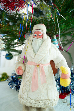 Slavic Grandfather Frost with a bag of gifts in his hand near the New Year tree
