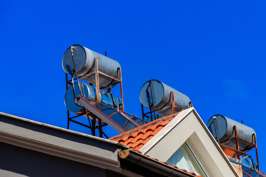 Solar water heaters on a residential house rooftop. Renewable energy for house