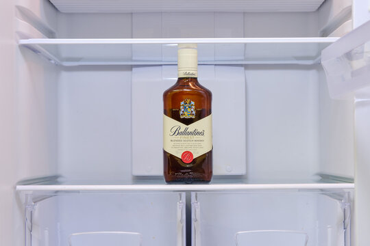 Alcohol bottles whiskey Ballantines in empty refrigerator - Moscow, Russia, January 06, 2021