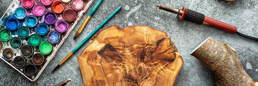 Woodworking and woodburning tools, paint and brushes