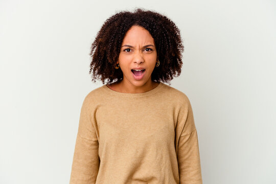 Young african american mixed race woman isolated shouting very angry, rage concept, frustrated.