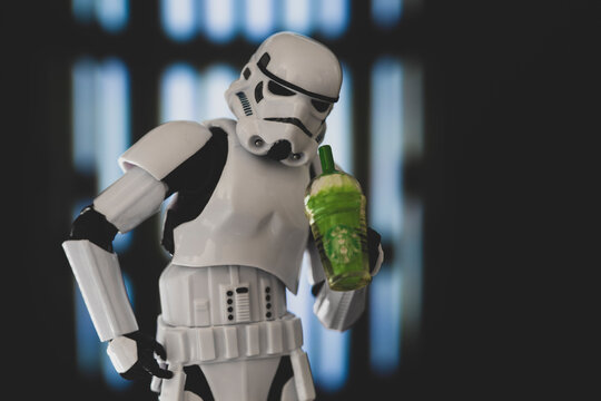 NEW YORK USA, JAN 25 2021: Star Wars Imperial Stormtrooper looks down straw of a Starbucks Frappuccino - humor - Hasbro action figure