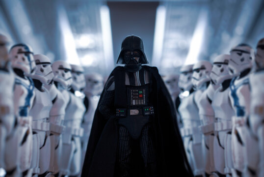NEW YORK USA, JAN 25 2021: Star Wars Sith Lord Darth Vader exits shuttle with row of Imperial Stormtroopers  - Hasbro action figure