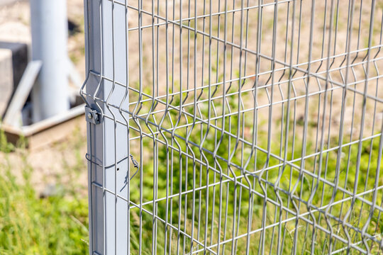 Steel wire lattice fence. Sectional metal fencing. Close-up. Selective focus