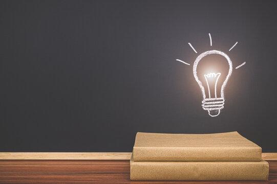 Read a book concept light bulb symbol on the blackboard represents an idea