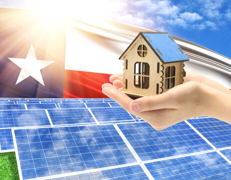 The photo with solar panels and a woman's palm holding a toy house shows the flag State of Texas in the sun.