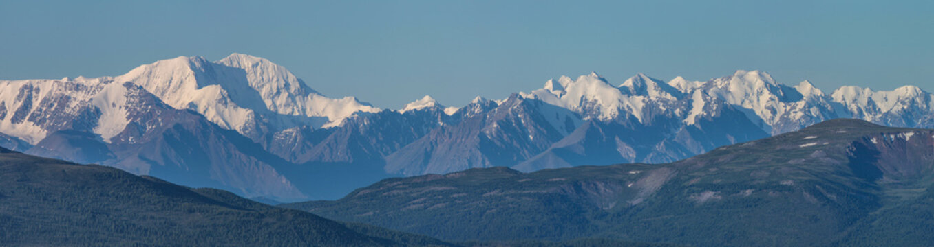 Large panorama. View of the snow-capped mountain range.