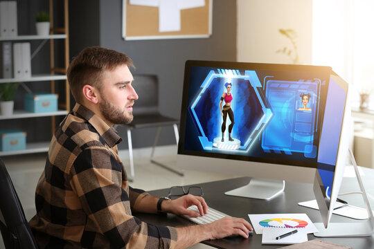 Male video games designer working in studio