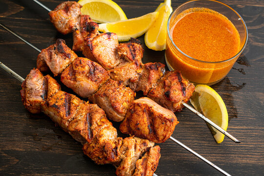 Pinchos Morunos - Spanish Pork Kebabs: Marinated chunks of pork tenderloin grilled on skewers and serves with paprika aioli and lemon wedges