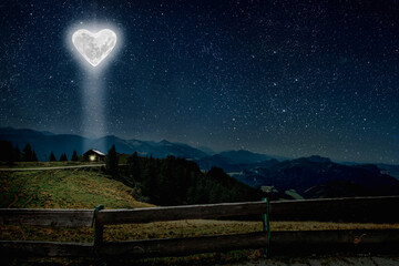 The moon heart-shaped shines over the lovers' house on valentine's day